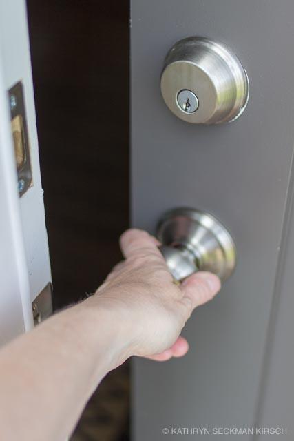 Hand opens door